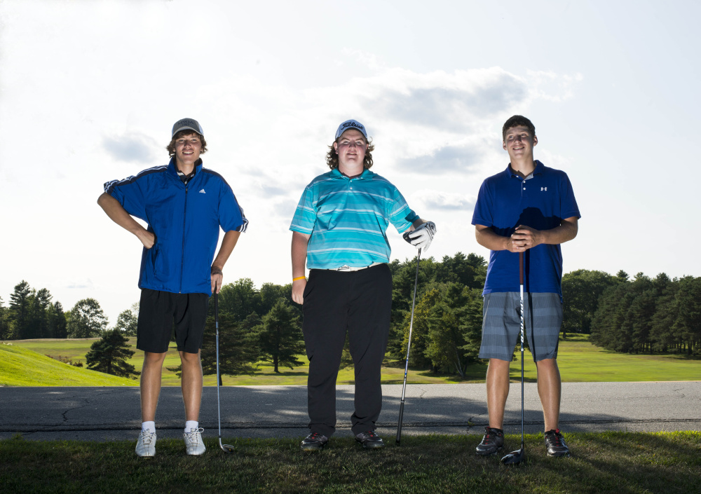 Erskine golfers, from left, Connor Paine, Aaron Pion and Justin Browne pose at Natanis Golf Course in Vassalboro on Thursday.