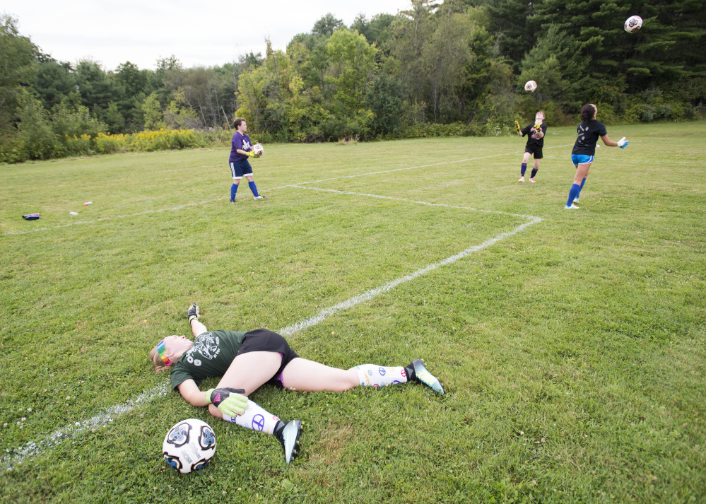 Ally Drew, a goalie for Waterville, stretches before working through drills at a preseason practice at Runnels Field in Waterville on Aug., 15.