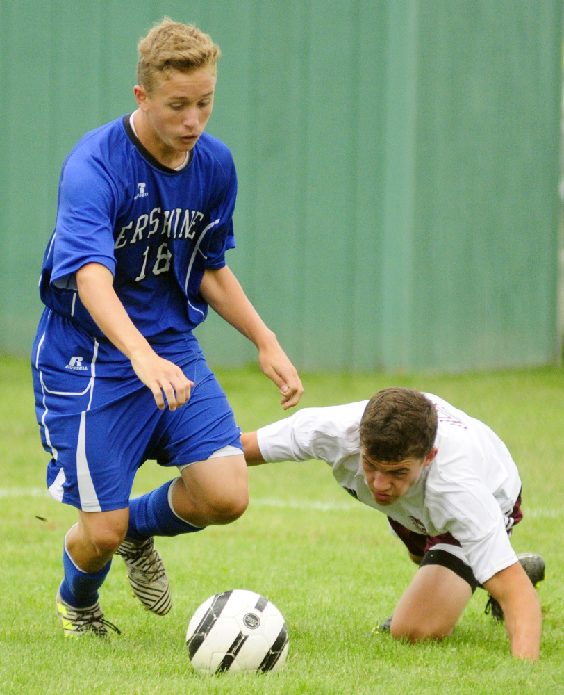 Erskine's Sam York, left, keeps the ball away from Monmouth defender Thomas Neal during an Aug. 19 play day in Augusta.