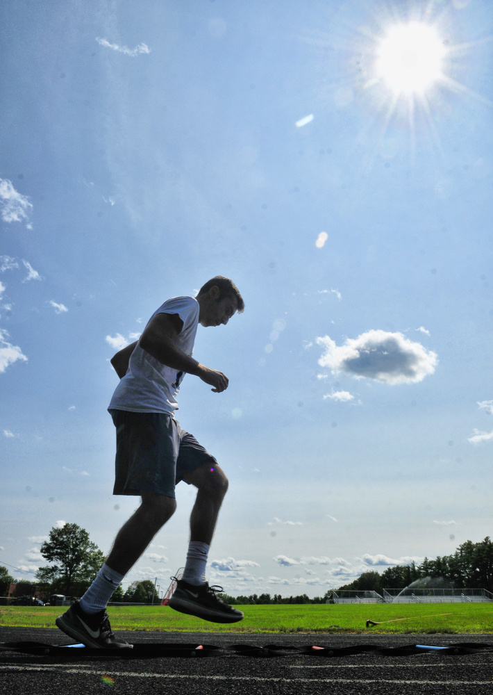 Hall-Dale soccer captain Tyler Nadeau hig- steps through an agility ladder duringan Aug 17 practice in Farmingdale.