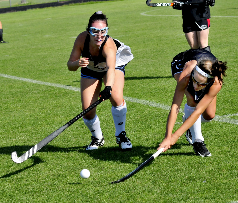 Skowhegan field hockey players Maliea Kelso, left, and Hannah McKenney compete during an Aug. 24 practice in Skowhegan.