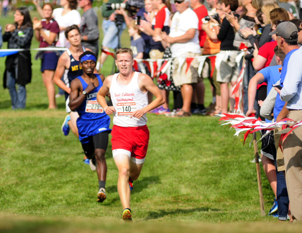 Cony's Caleb Richardson runs past fans in the last mile of the annual Scot Laliberte Invitational on Aug. 25 at Cony High School in Augusta.