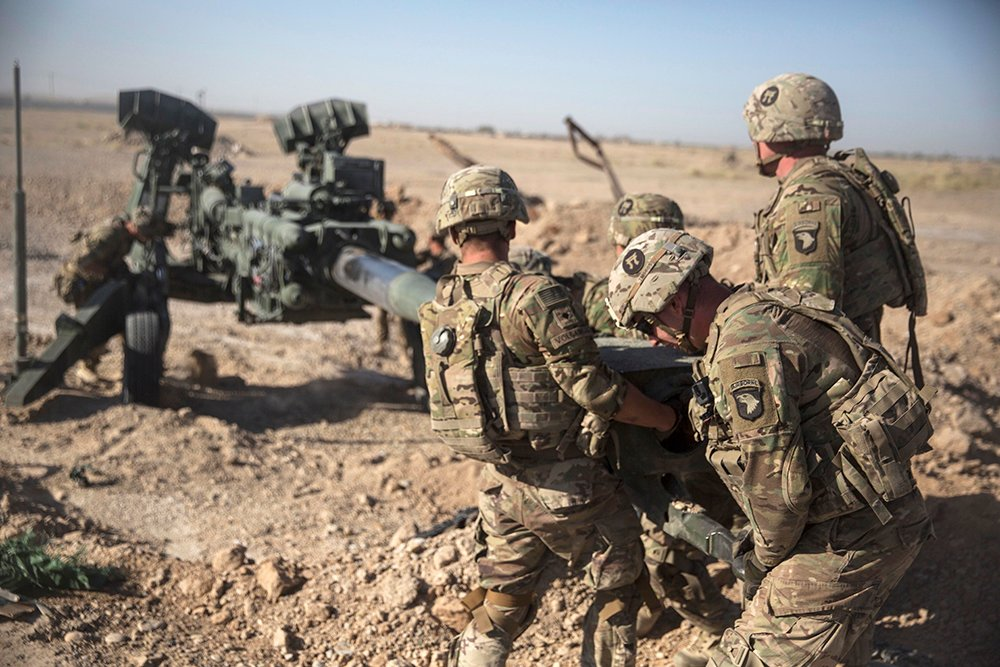 U.S. soldiers with Task Force Iron maneuver an M-777 howitzer into position at Bost Airfield, Afghanistan, on June 10, 2017.