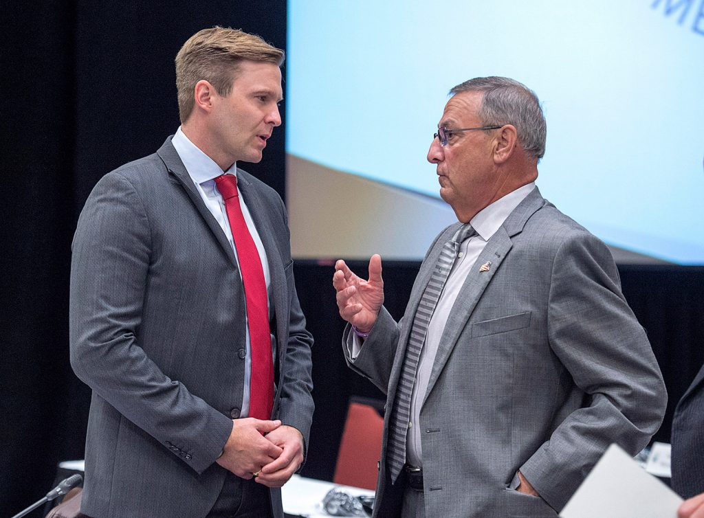 New Brunswick Premier Brian Gallant, left, and  Gov. Paul LePage chat at the start of a meeting of New England governors and Eastern Canadian premiers in Charlottetown, Prince Edward Island.