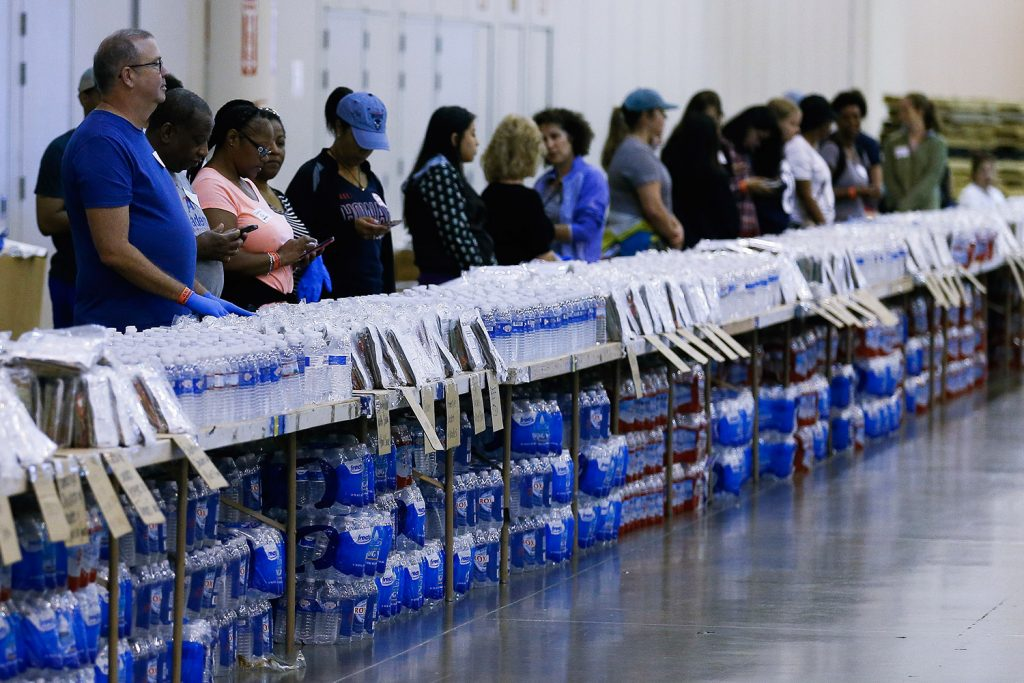 Volunteers get ready to help at a food and water line at NRG Center, which opened its doors to evacuees in the wake of Harvey, on Wednesday in Houston.