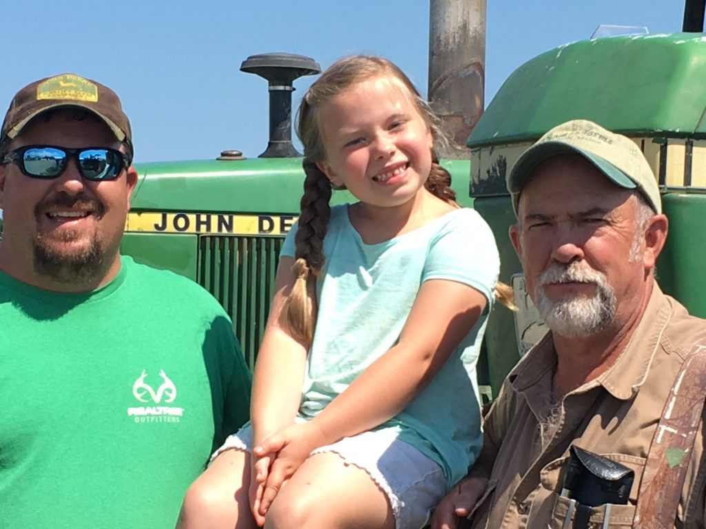 Thomas is a true family farm. From left, Paul Thomas, his daughter Taylar, 6, and his dad, Frank.