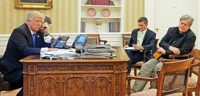 President Trump speaks by phone with Australia's Prime Minister Malcolm Turnbull in the Oval Office on Jan. 28, 2017. Then-national security adviser Michael Flynn and senior adviser Steve Bannon listen in.
