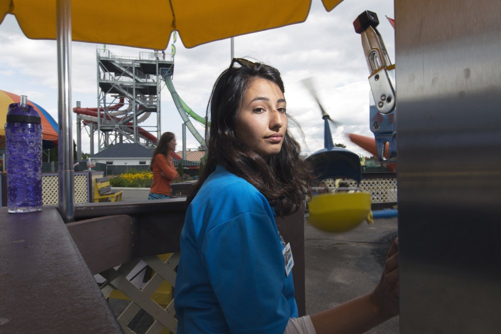 Ceren Han, 20, of Turkey operates a ride Thursday at Funtown Splashtown USA in Saco. Han holds a J-1 visa,which allows foreign college students to work in the U.S. as part of a cultural exchange program.