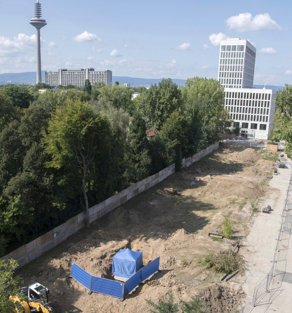 A blue tent covers an unexploded 1.8-ton World War II-era bomb in Frankfurt, Germany, on Friday. The British bomb is supposed to be defused on Sunday.