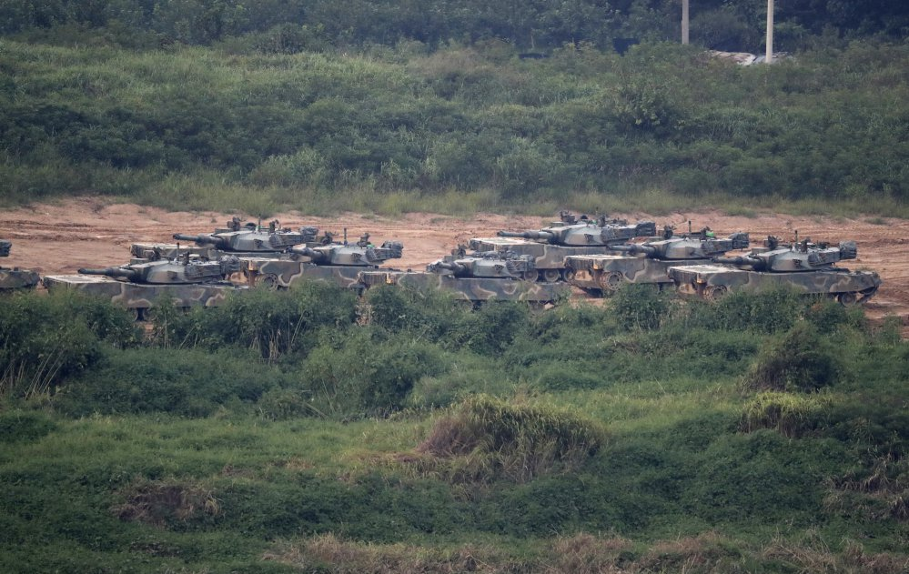 "South Korean K-1 tanks are seen in Paju, South Korea on Sunday. North Korea announced it detonated a thermonuclear device Sunday in its sixth and most powerful nuclear test to date, a big step toward its goal of developing nuclear weapons capable of striking anywhere in the U.S. The North called it a ""perfect success"" while its neighbors condemned the blast immediately."