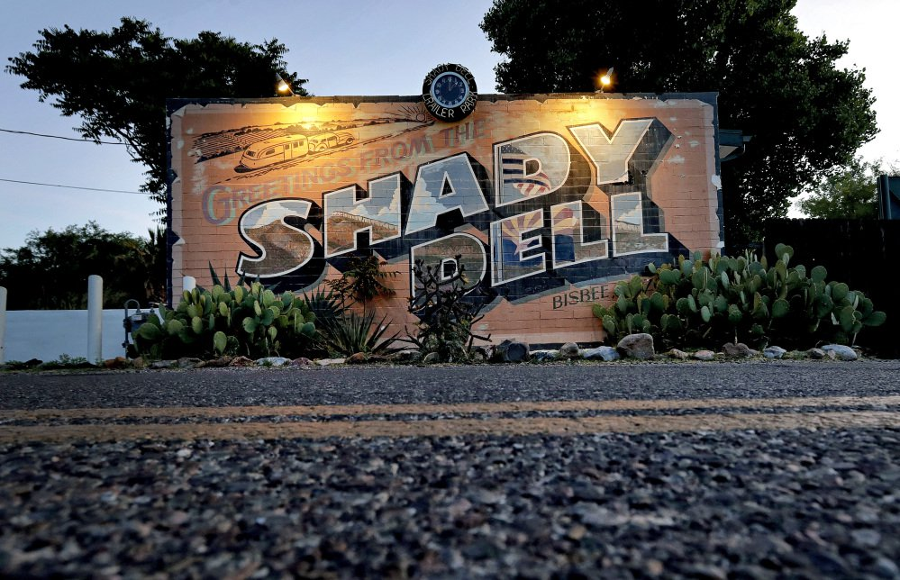 The front office of the Shady Dell trailer court is illuminated at dawn in Bisbee, Ariz., near Highway 80. The rest haven in the tiny mining town was a frequent stop for motorists during the golden age of American automobile travel.