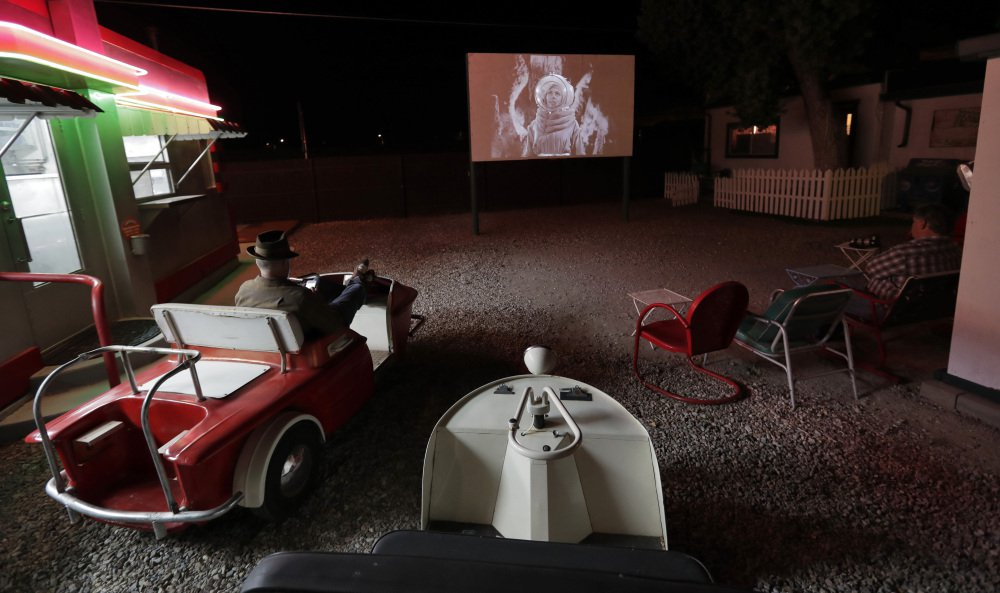 "The 1953 movie ""Cat Women of the Moon"" is shown on the big screen at the Shady Dell trailer court. Movies and ads from the 1950s are shown nightly adjacent to the snack bar, with vintage golf carts and automobiles used for seating."