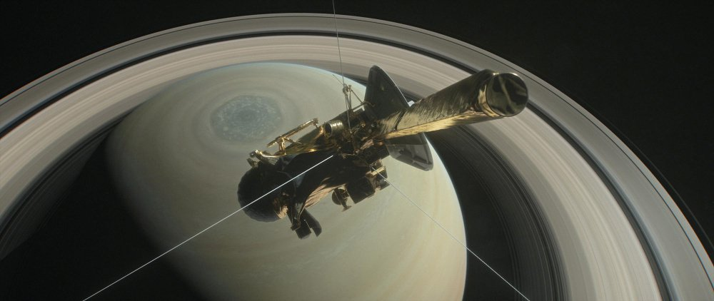The spacecraft Cassini is pictured above Saturn's northern hemisphere prior to making its grand finale dive Friday in this NASA handout illustration obtained by Reuters.