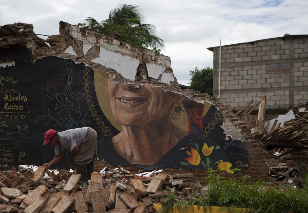 A man recovers bricks Sunday from a building destroyed in Thursday's magnitude 8.1 earthquake in Union Hidalgo, Mexico, a town of about 20,000 people.
