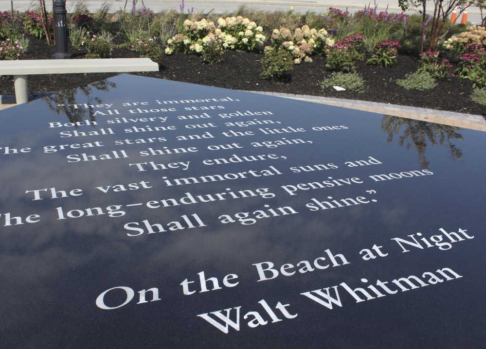 "A table containing the Walt Whitman poem ""On the Beach at Night"" is part of a memorial being dedicated in Hempstead, N.Y., Monday. The memorial also includes names of people who died of illnesses from working at Ground Zero."