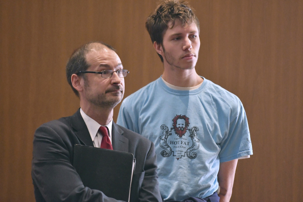 Orion Krause, right, stands with his attorney, Edward Wayland, at Krause's arraignment in Ayer District Court on Sept. 11. Krause has been found competent to stand trial.