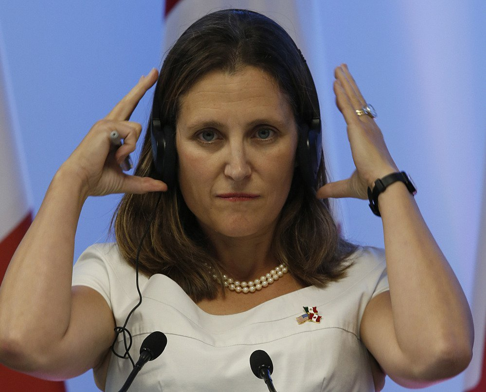 Chrystia Freeland adjusts her headphones during a news conference at NAFTA talks. She's guiding Canada's work on the trade deal and met with labor leaders before talks began.