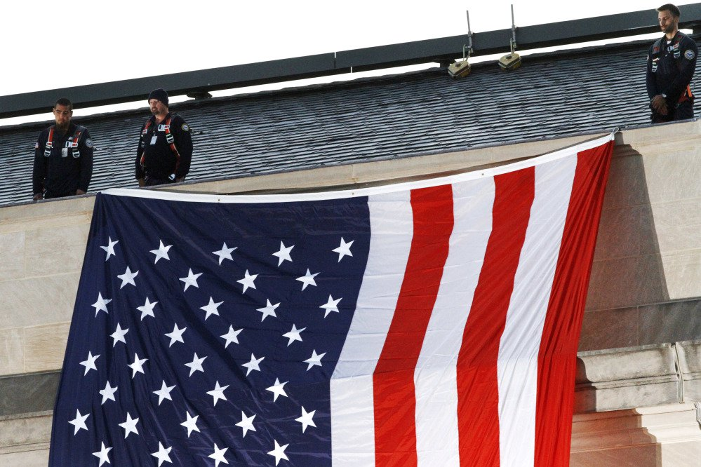 A U.S. flag is unfurled at the Pentagon on the 16th anniversary of the Sept. 11 terrorist attacks Monday.