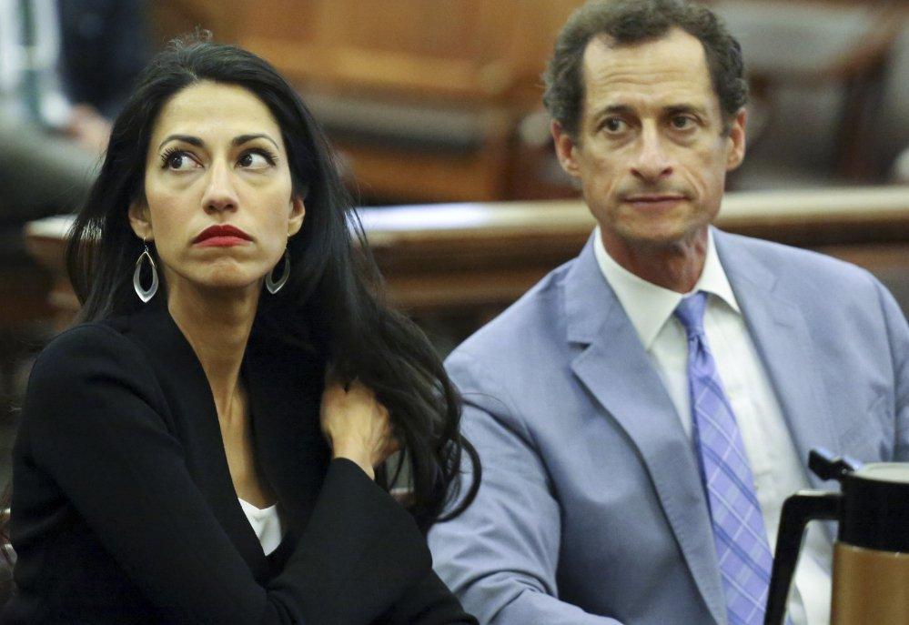 Huma Abedin and Anthony Weiner are seen in court Wednesday in New York.