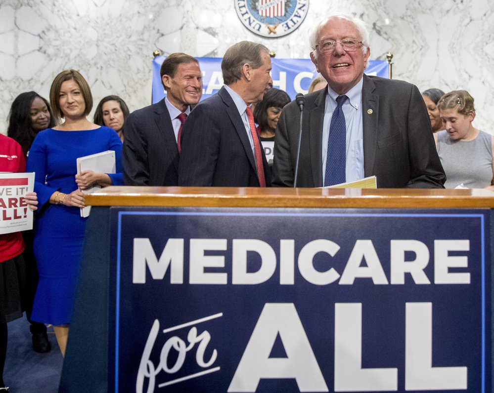 Backed by Democratic senators and liberal activists, Sen. Bernie Sanders unveils his proposal for a single-payer national health care system.