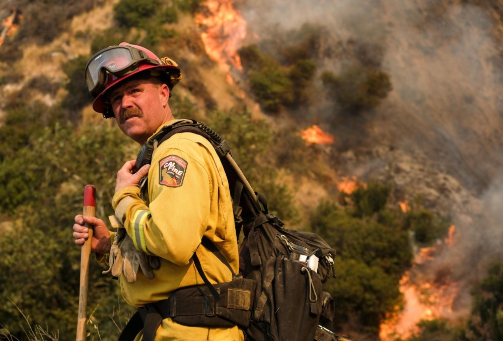 A crew member with the California Department of Forestry and Fire Protection battles a brush fire on a hillside in Burbank, Calif., earlier this month.