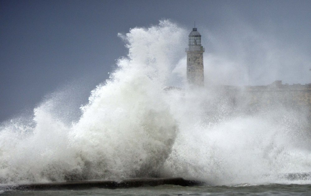 Waves crash into El Morro after the passing of Hurricane Irma in Havana, Cuba, last Sunday. The powerful storm ripped roofs off houses, collapsed buildings and flooded hundreds of miles of coastline.