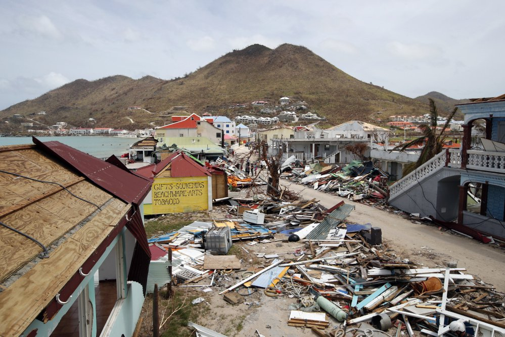 "Hurricane Irma heavily damaged buildings along the shore of St. Maarten, and homes were leveled in the neighborhood of Lisa MacVane of Raymond, including her own. ""It was completely torn down,"" said MacVane, a medical student who took shelter in a building on campus."