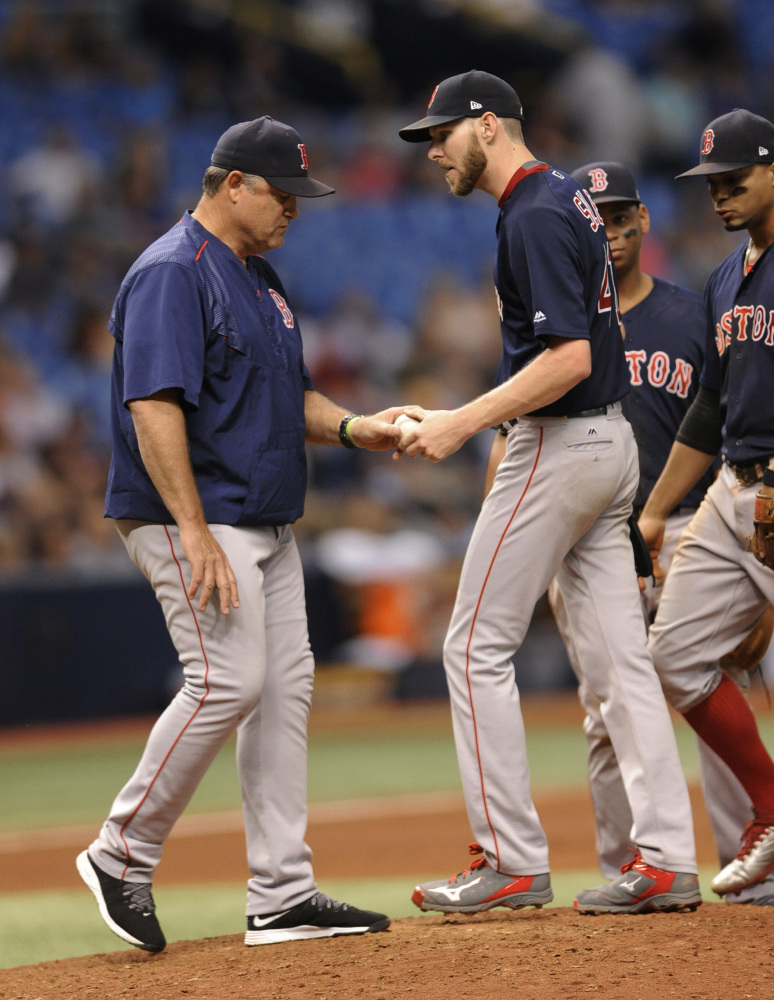 Boston Red Sox manager John Farrell, left, pulls starter Chris Sale during the sixth inning Friday night. Sale allowed four runs on six hits and three walks while striking out nine in 5   innings of work.