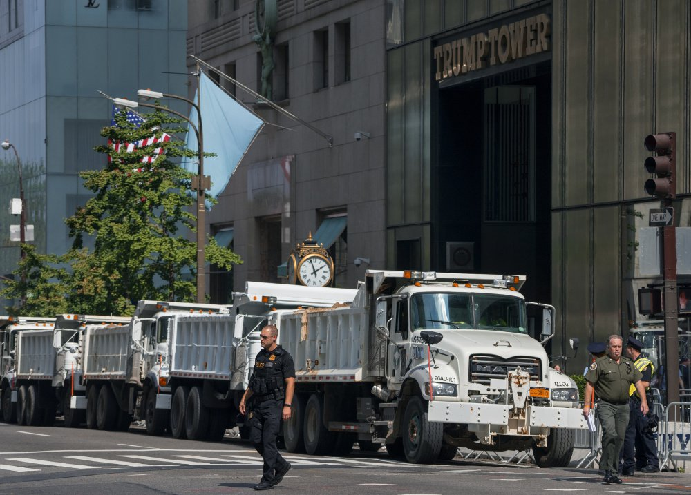Dump trucks full of sand are lined up along Fifth Avenue in front of Trump Tower in New York on Sunday. World leaders gather at the United Nations starting Monday. President Trump and France's new leader, Emmanuel Macron, will both be making their first appearance at the General Assembly.