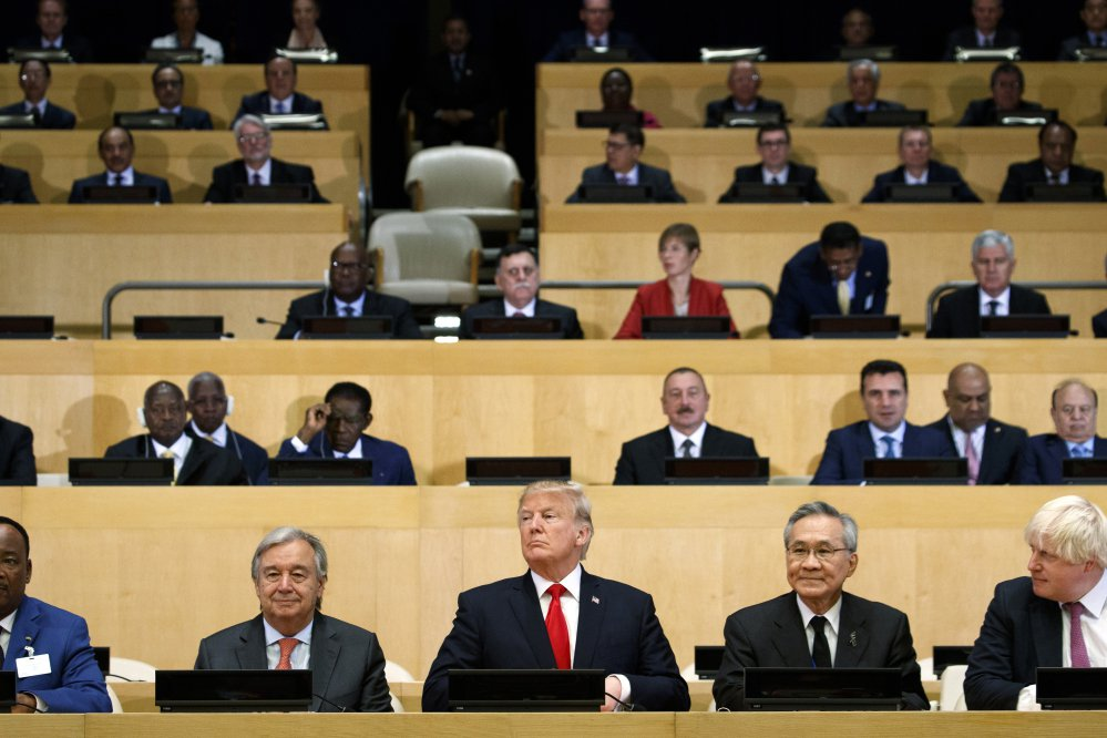 "President Trump participates in a photo shoot before the beginning of the ""Reforming the United Nations: Management, Security, and Development"" meeting during the United Nations General Assembly on Monday at U.N. headquarters."