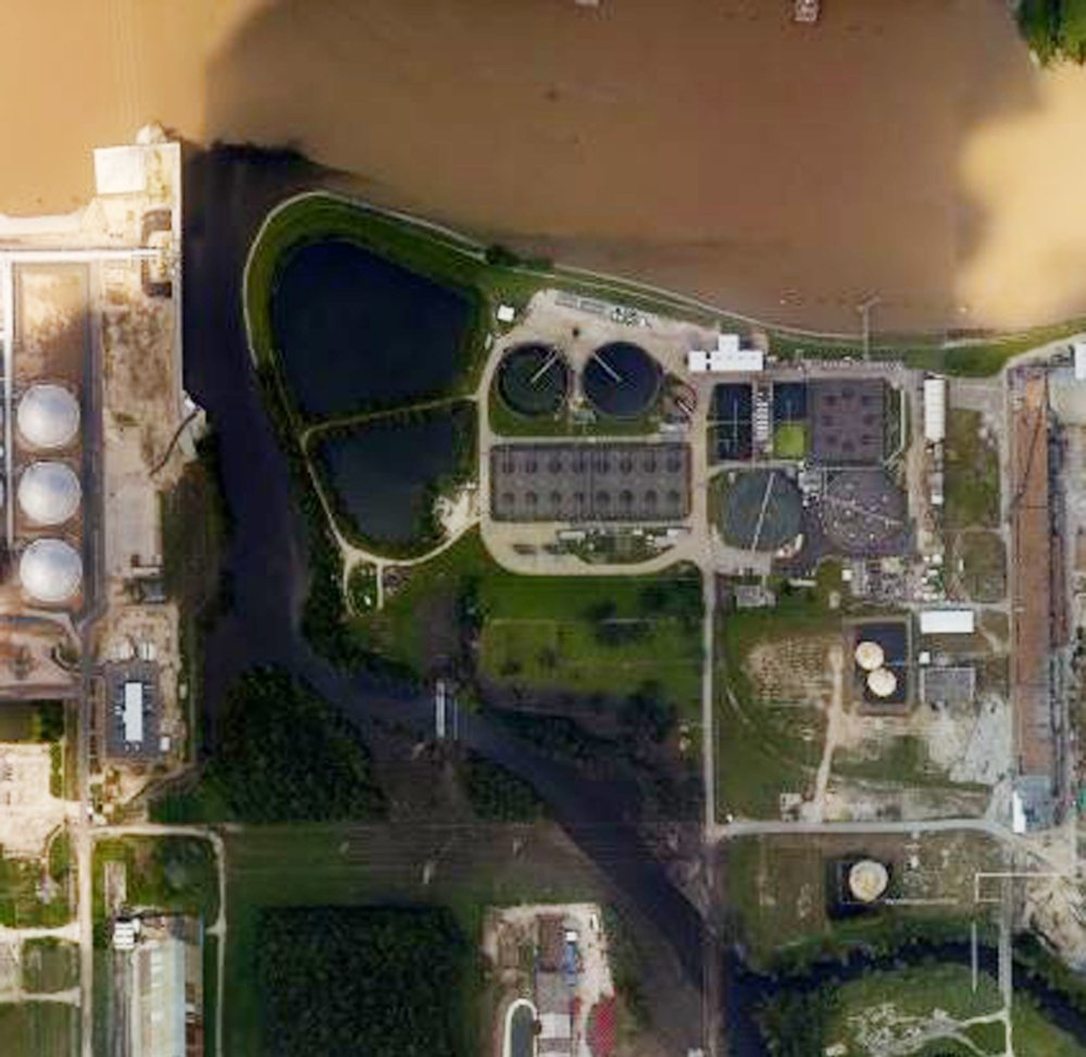 Aerial photo from NOAA shows floodwaters surrounding the U.S. Oil Recovery Superfund site outside Houston flowing into the San Jacinto River. The EPA is still assessing damage.