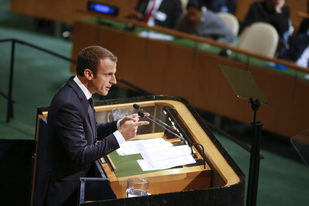 French President Emmanuel Macron addresses members of the U.N. Tuesday. How vowed to push on with the Paris accord, from which the U.S. has said it is withdrawing.