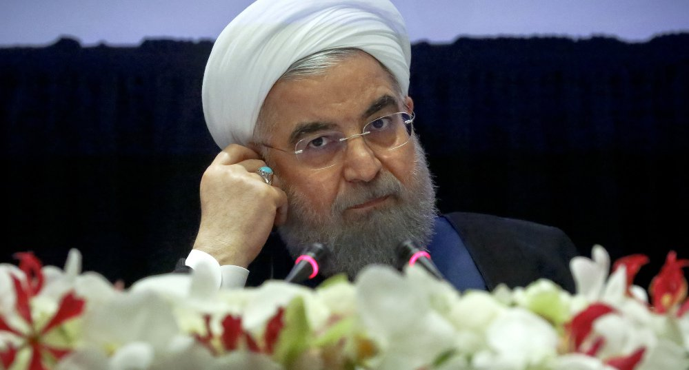 Iran's President Hassan Rouhani listens at a news conference during his visit for the United Nations General Assembly, Wednesday Sept. 20, 2017, in New York. President Donald Trump said he has made a decision on whether to walk away from the landmark 2015 nuclear deal with Iran but refused to say what it is, setting the stage for a particularly contentious meeting of the parties to the agreement. (AP Photo/Bebeto Matthews)