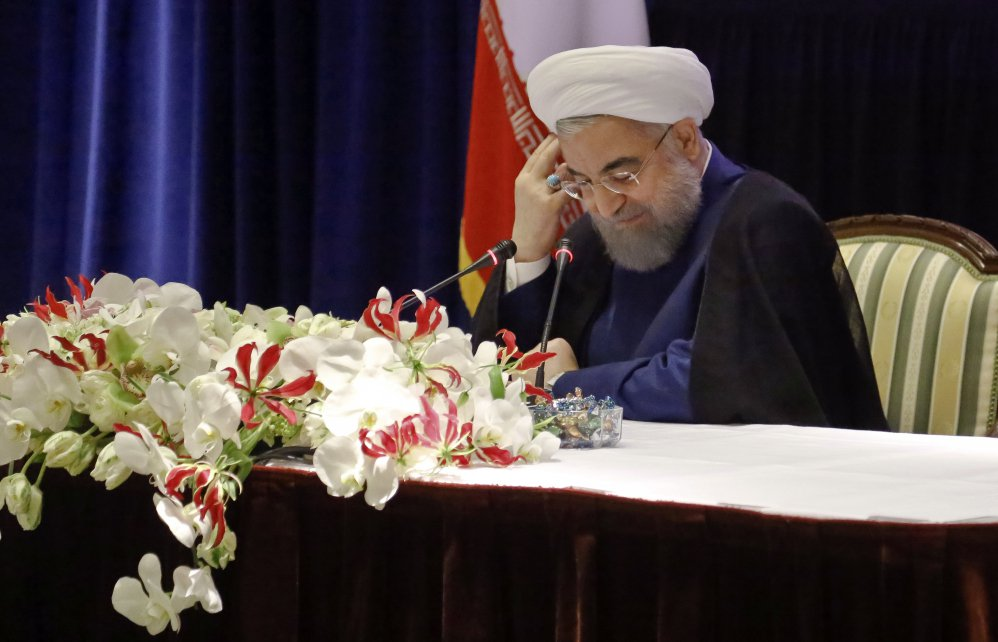 Iranians President Hassan Rouhani listens during a news conference about his visit to the United Nations General Assembly on Wednesday in New York.
