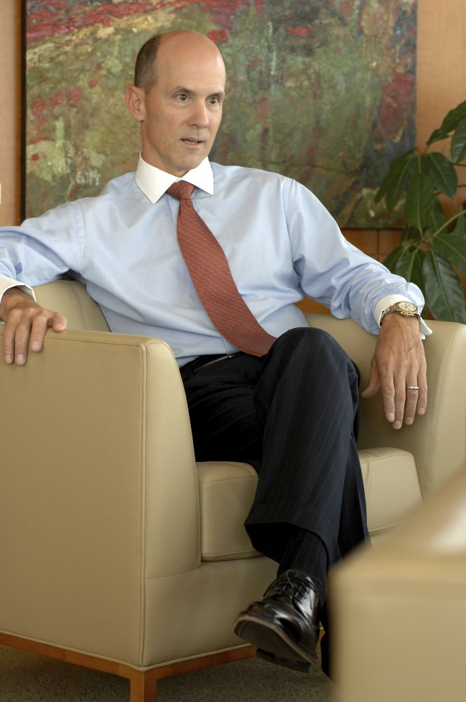 In this May 30, 2007, photo Equifax CEO Richard Smith poses for a photo at the Equifax headquarters in Atlanta. State and federal authorities are proposing tougher regulations against Equifax and the entire credit monitoring industry after the company announced that personal information like Social Security numbers of about 143 million Americans was exposed. (Joey Ivansco/Atlanta Journal-Constitution via AP)
