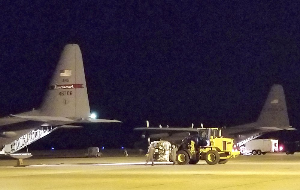 Seven members of a specialized Maine Air National Guard communications team left for the U.S. Virgin Islands on Thursday to assist recovery efforts after hurricanes Irma and Maria battered the region. A trailer is backed onto a plane bound for St. Croix.
