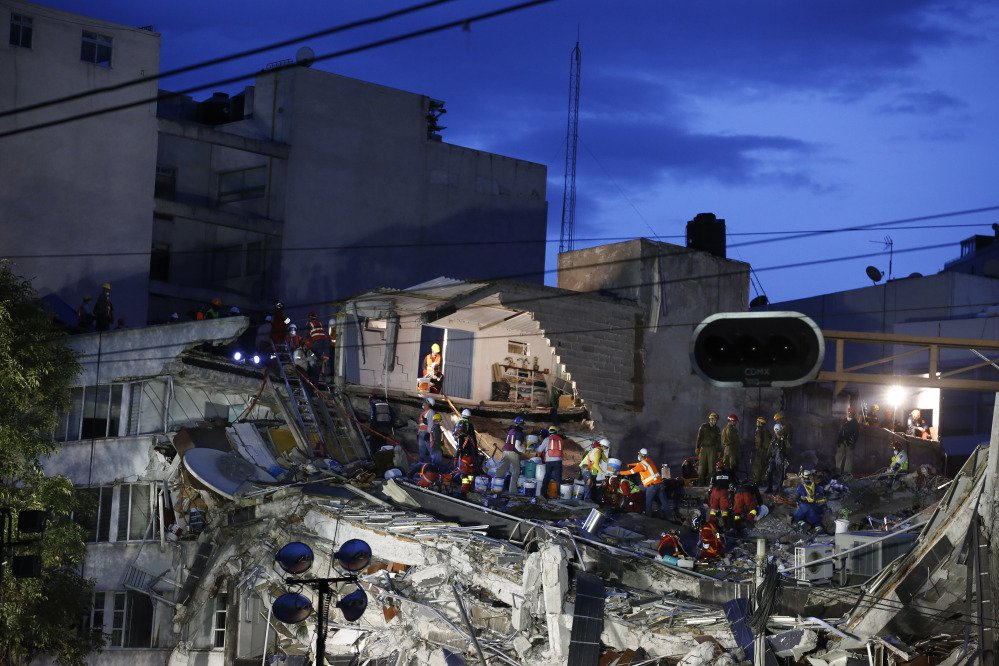 Rescuers race to save people believed to be still alive inside a collapsed office building in the Roma Norte neighborhood of Mexico City on Friday night, three days after a 7.1 magnitude earthquake. Hope mixed with fear Friday in Mexico City, where families huddled under tarps and donated blankets, awaiting word of their loved ones trapped in rubble.