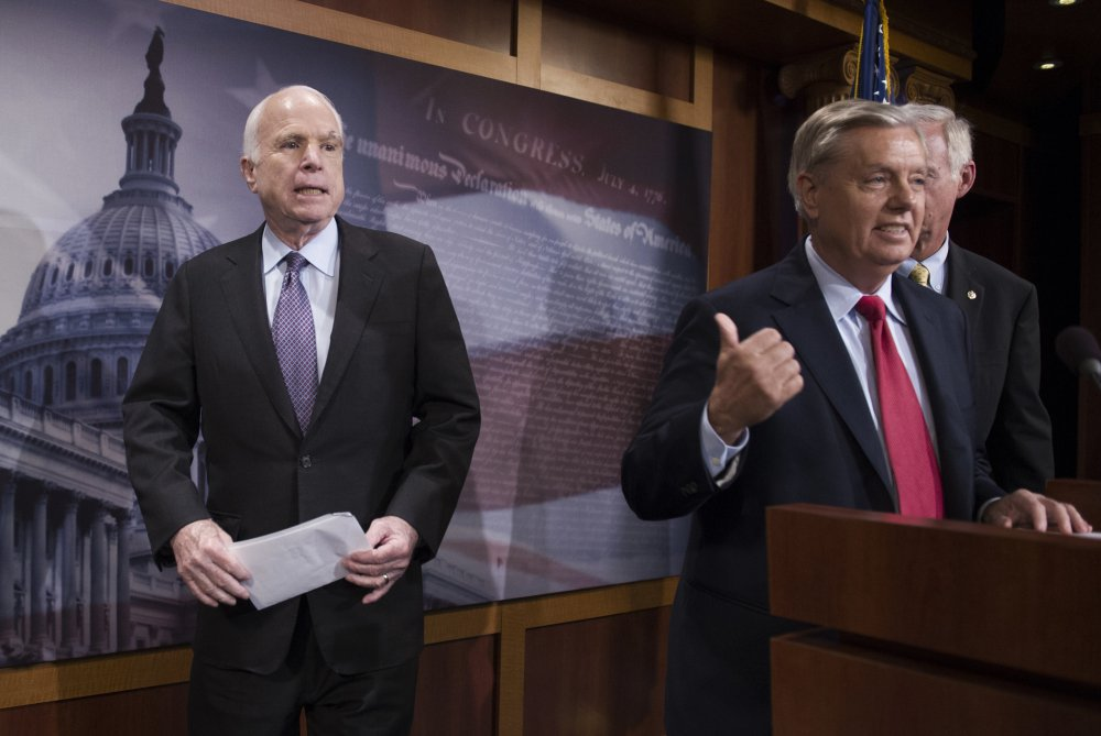 Sen. John McCain, R-Ariz., left, broke with longtime friend Lindsey Graham, R-S.C., center, on Graham's bill to repeal Obamacare. President Trump took to Twitter on Saturday morning to complain about McCain's position.