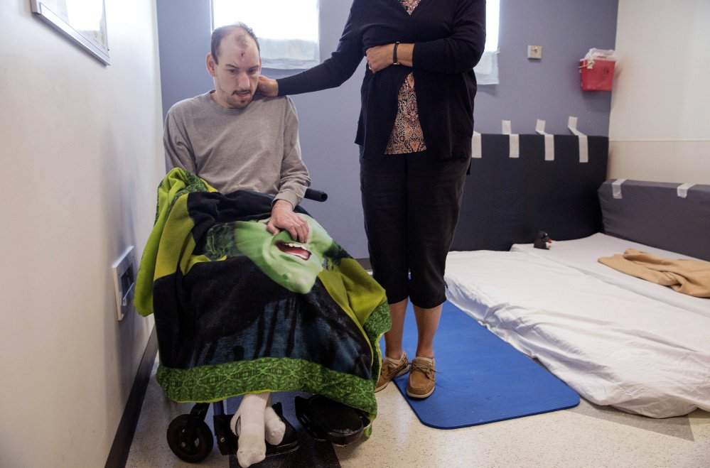 For two months now, Mark Madore, 34, who has developmental disabilities and experiences seizures, has been staying in this room with makeshift padding in the emergency department at Redington-Fairview General Hospital in Skowhegan. He was evicted from his group home in Embden after his mother, Cathy Madore, right, had one of his direct care workers administer medical marijuana to treat his seizures.