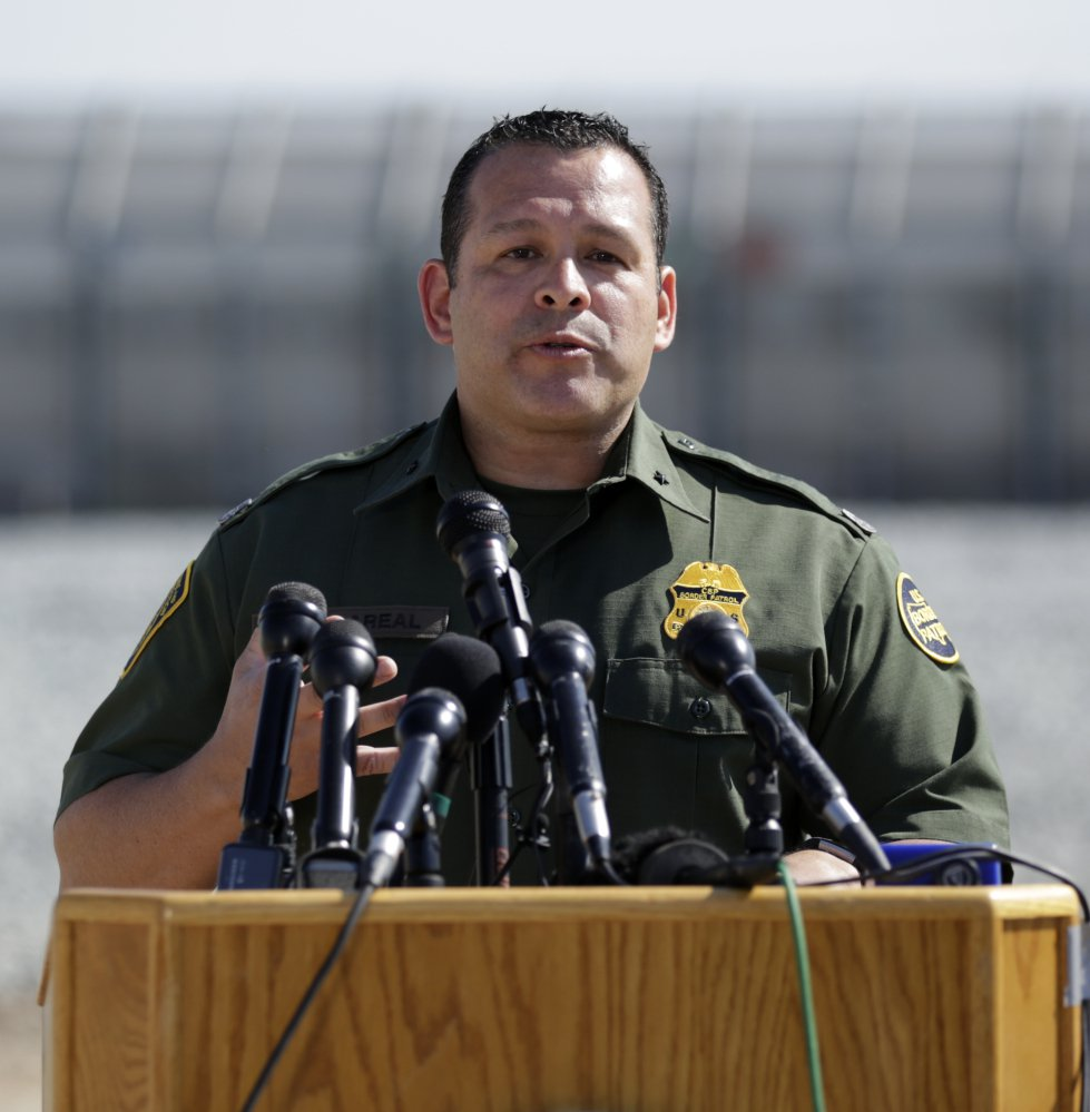 Roy Villarreal, of the U.S. Border Patrol, speaks at a news conference at the San Diego-Mexico border near Tijuana on Tuesday.l