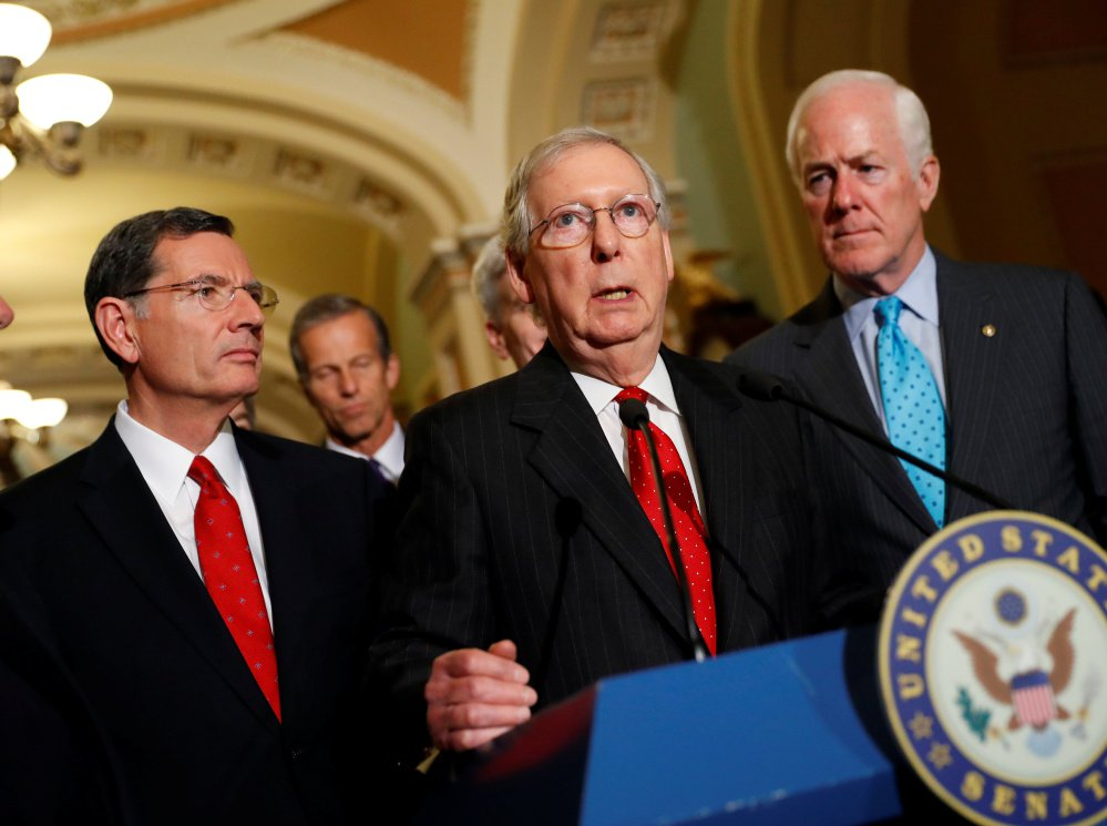 Senate Majority Leader Mitch McConnell (Ky.), accompanied by, from left, Republican Sens. John Barrasso (Wy.) and John Cornyn (Texas), speaks with reporters following the party luncheons on Capitol Hill in Washington, D.C., Tuesday, prior to the Alabama Senate primary results.