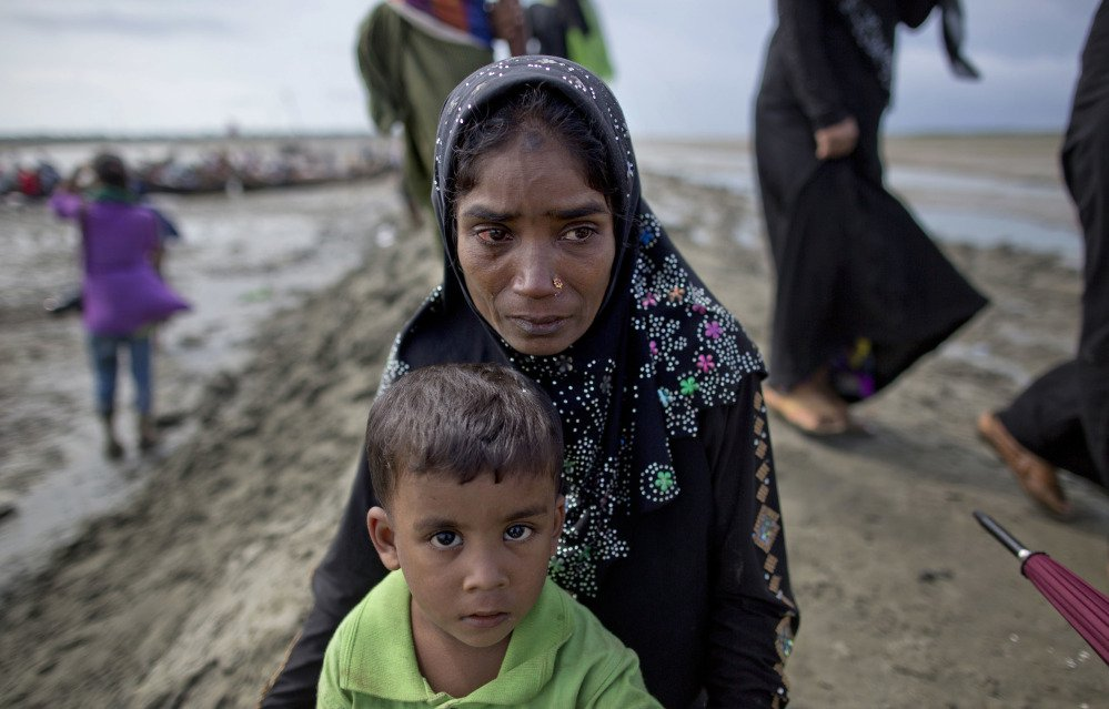 Tears roll down the cheek of a Rohingya Muslim woman who crossed over the border from Myanmar into Bangladesh in Teknaf.