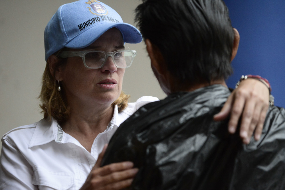 San Juan Mayor Carmen Yulin Cruz arrives at the San Francisco hospital during the evacuation of patients after an electrical plant failure, in San Juan, Puerto Rico, Saturday, Sept. 30, 2017. President Donald Trump is lashing out at the mayor of Puerto Rico's capital city in a war of words over recovery efforts after Hurricane Maria smashed into the U.S. territory. Trump is out with a series of tweets criticizing Cruz for criticizing the Trump administration's hurricane response.