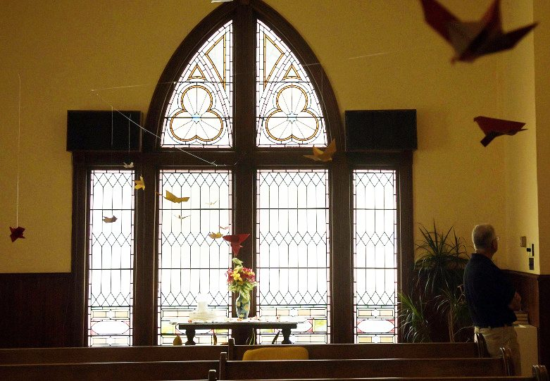 Stained glass windows greet visitors to the chapel of the Winthrop Congregational Church on Wednesday.