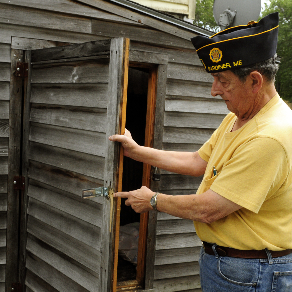 American Legion Post 4 Adjutant Roger Paradis talks Friday about the reinforced hardware added to the bottle storage shed after recent burglaries at the American Legion Smith Wiley Post 4 in Gardiner.