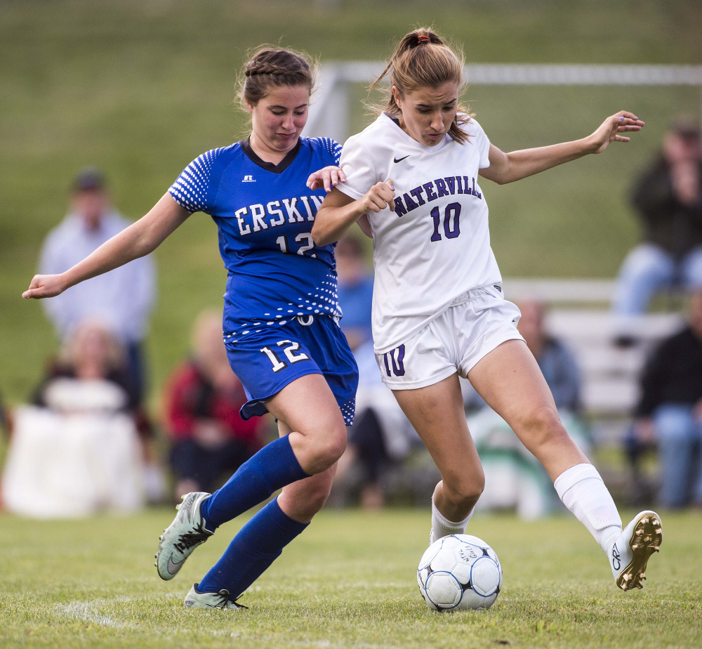 Erskine's Lydia Boucher (12) battles with Waterville's Sadie Garling in the second half during a Class B North game Friday at Webber Field in Waterville.