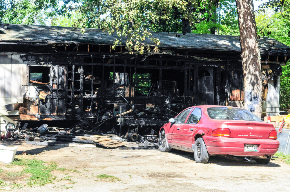 Staff photo by Joe Phelan After a fire Friday at this Farmingdale home displaced a family of eight.
