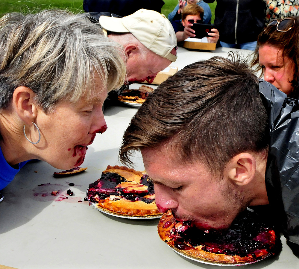 Candidates for Maine political offices compete in a pie eating contest following a Labor Day rally in Waterville on Sunday. From left are Democrat candidates for Governor Betsy Sweet of Hallowell and Patrick Eisenhart of Augusta and U.S. Senate candidate Zak Ringelstein who won the contest.