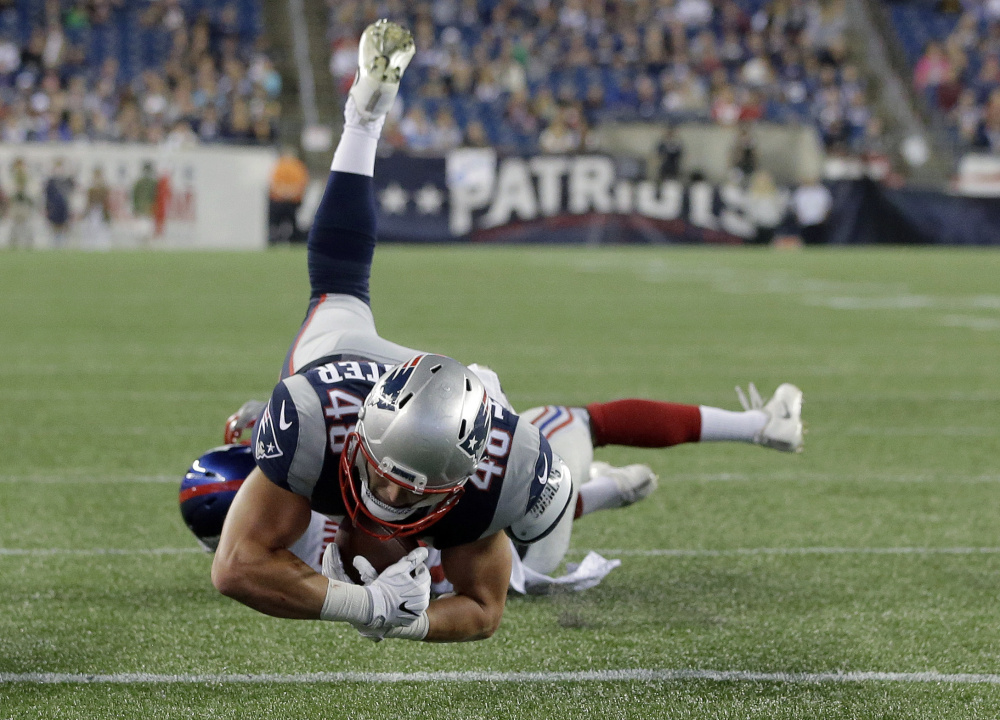 New England Patriots tight end Jacob Hollister dives over the goal line for a touchdown against the New York Giants during the second half of an AUg. 31 preseason game in Foxborough, Massachusetts.