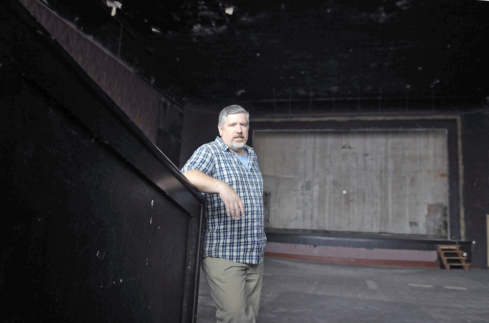 Mike Miclon stands in the main theater of Johnson Hall in Gardiner in September 2016. The theater is working to raise an estimated $4.8 million for renovations.